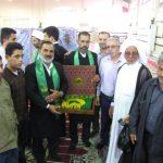 گزارش تصویری/خادمان حامل پرچم حرم مطهر امام رضا(ع) در نماز جمعه کارون